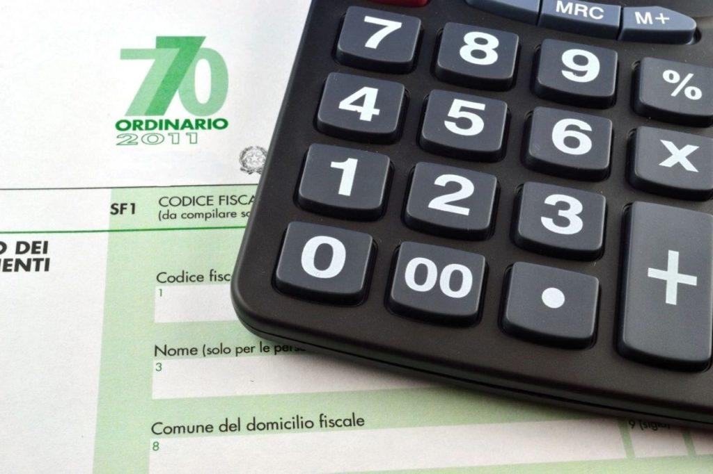 Codice Fiscale paper under caculator