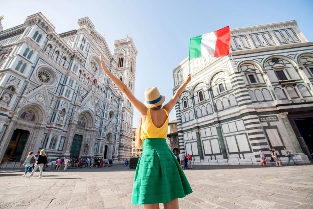 A Girl is Posing for a Picture with Italian Flag