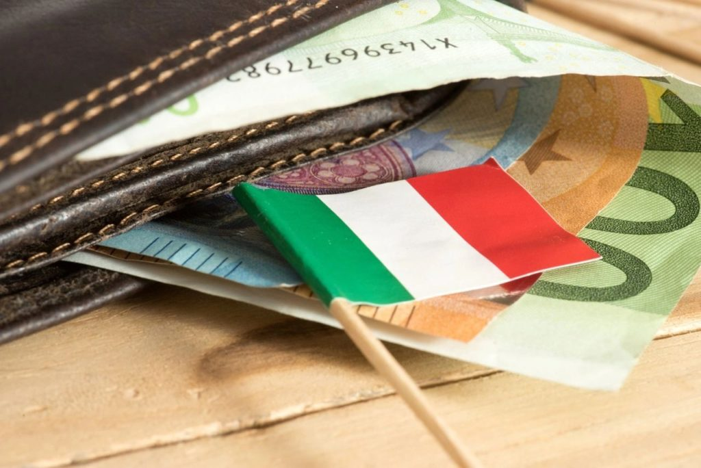 Paper Italian flag on top of euros
