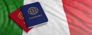 Two passports on Italian flag