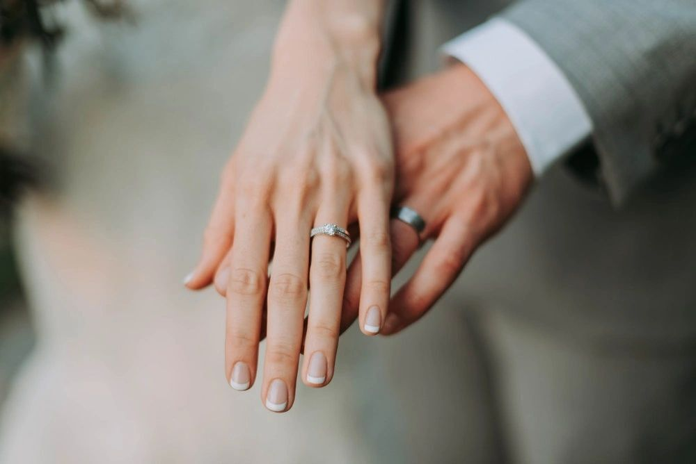 A Couple showing their rings