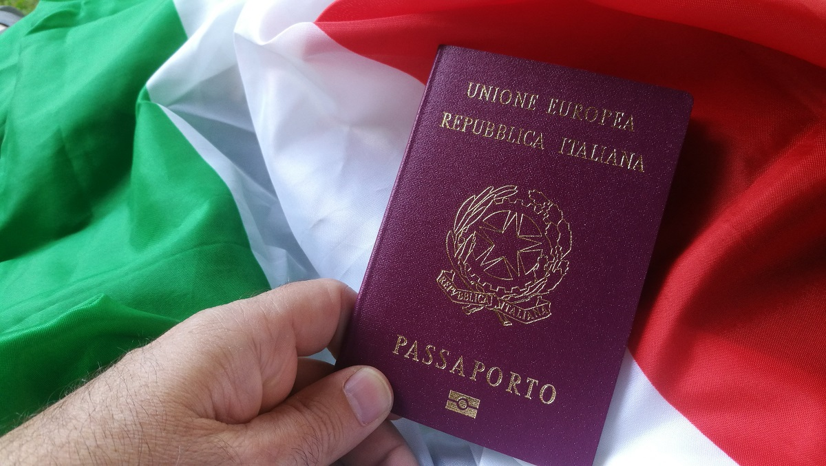 Italian European Passport on Italian Flag