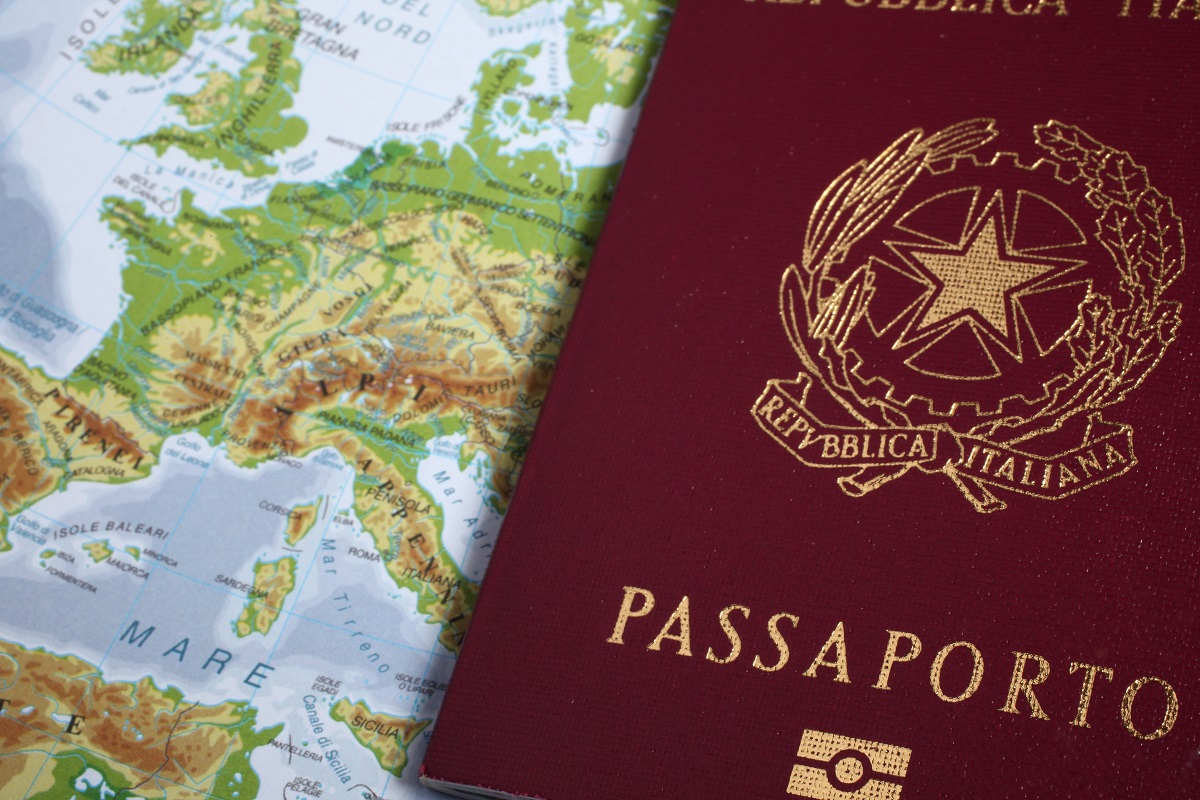 Italian passport on a geographical map
