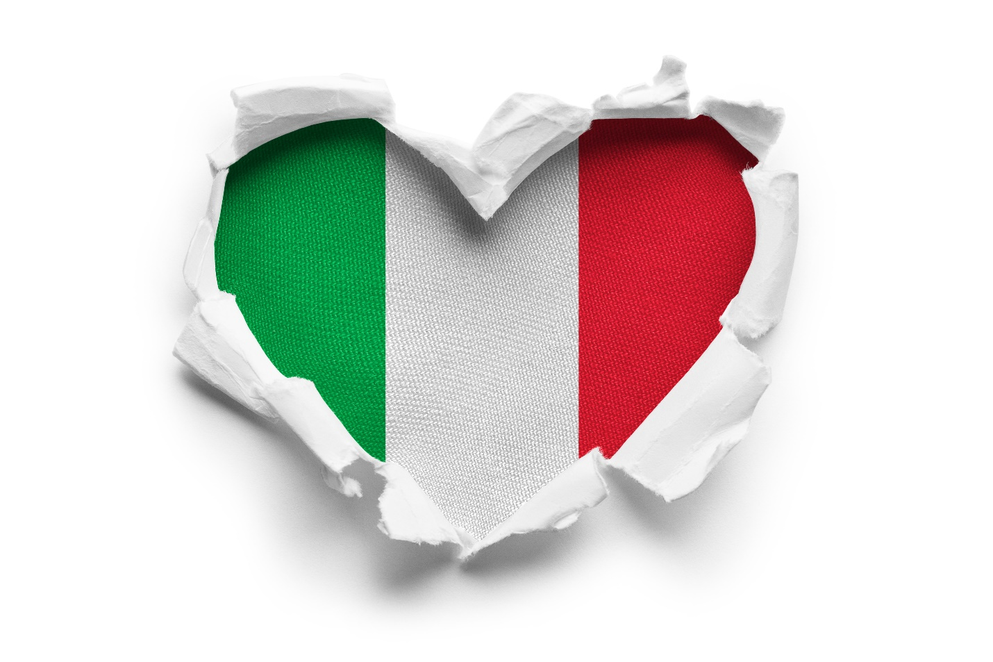 Heart shaped hole torn through paper, showing satin texture of flag of Italy
