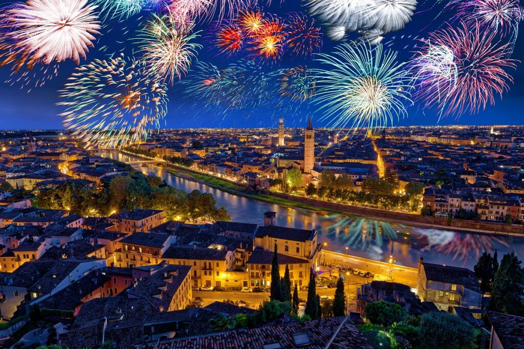 Colorful Fireworks above Verona Cityscape, in Italy
