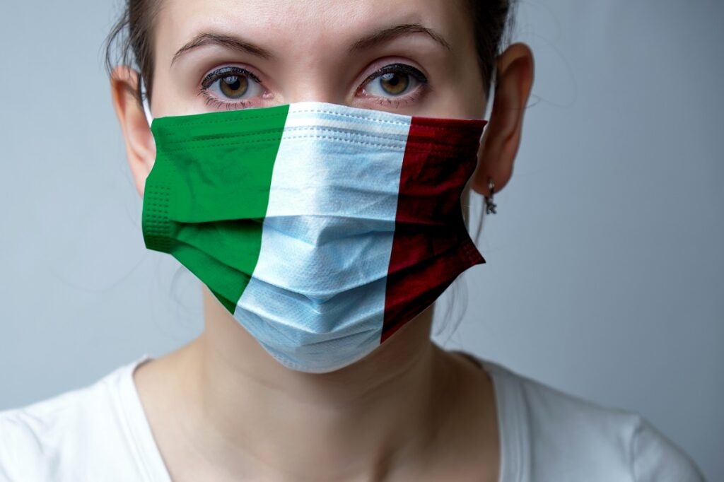 Girl in a medical protective mask. Abstract Italy flag on fabric