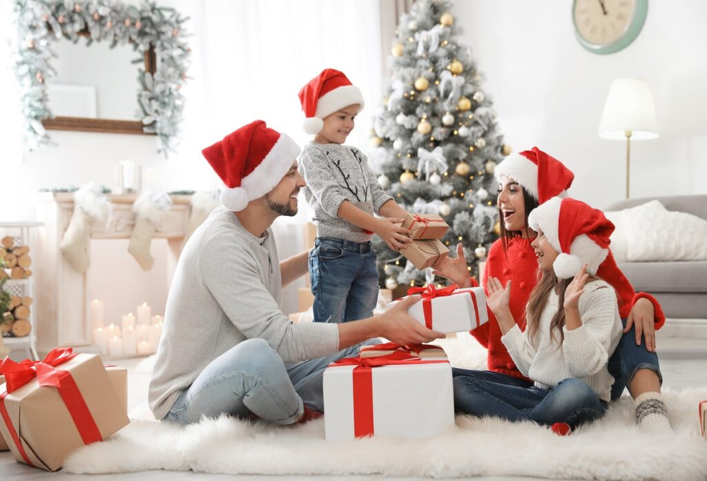 Happy family with children and Christmas gifts